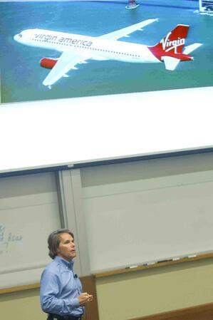 Virgin America CEO David Cush illuminates a case study during orientation