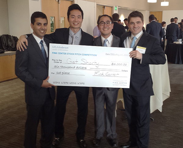 The Investment Club team, left to right: Miran Ahmad, MBA 15; Carl Choi, MBA 16; Scott Furumoto, MBA 15; and Zane Keller, MBA 15