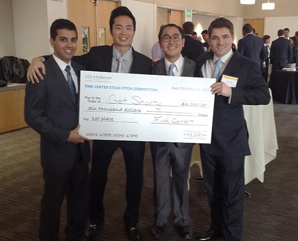 The Investment Club team, left to right: Miran Ahmad, MBA 15; Carl Choi, MBA 16; Scott Furumoto, MBA 15; and Zane Keller, MBA 15