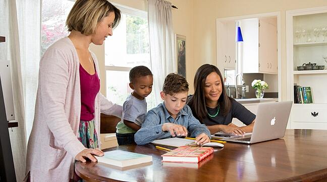 Part-time MBA Student Celia Carter at home with family