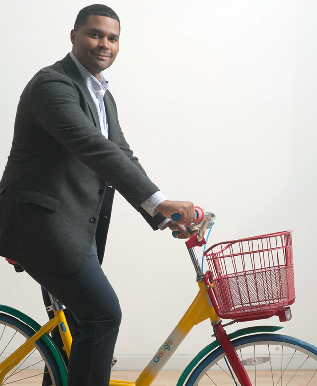 Berkeley Evening & Weekend student Christopher Jones on a Google Bike