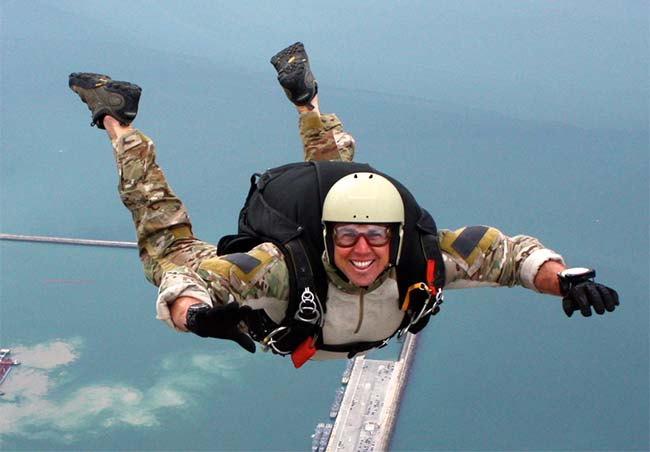 Berkeley MBA student and military member Nick Stoner on a jump