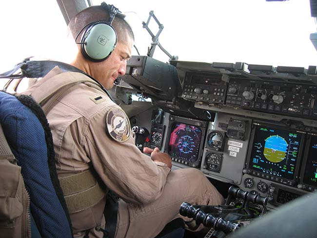 Berkeley EMBA student and military reservist Ricky Cornejo in the cockpit